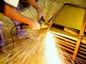 Image of man grinding with sparks flying
